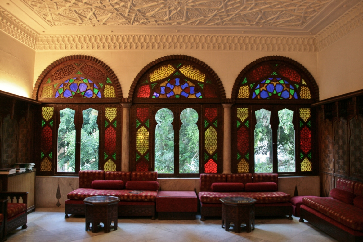The OIB's reception room boasts impressive stain-glass windows, three walls of intricate wooden panelling and an ornate Arabesque ceiling. The Farjallah mansion was once one of hundreds in Zoqaq al-Blat, which sprung up when Beirut became overcrowded in the late 19th century and the city's wealthy built their villas in the surrounding countryside. [Venetia Rainey/Al Jazeera]