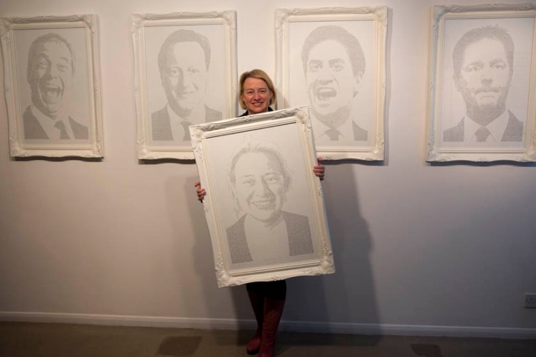 Green Party leader Natalie Bennett holds a portrait made up of words hand-written from people's Twitter opinions [AP]