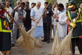 Prime Minister Narendra Modi has initiated cleanup programmes while expanding business [AP/Press Trust of India]