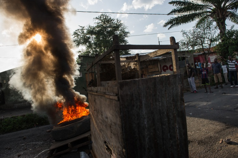 Early on May 4, protesters erected burning barricades in run-up to protests and street battles with police that run through the day. [Phil Moore/Al Jazeera]
