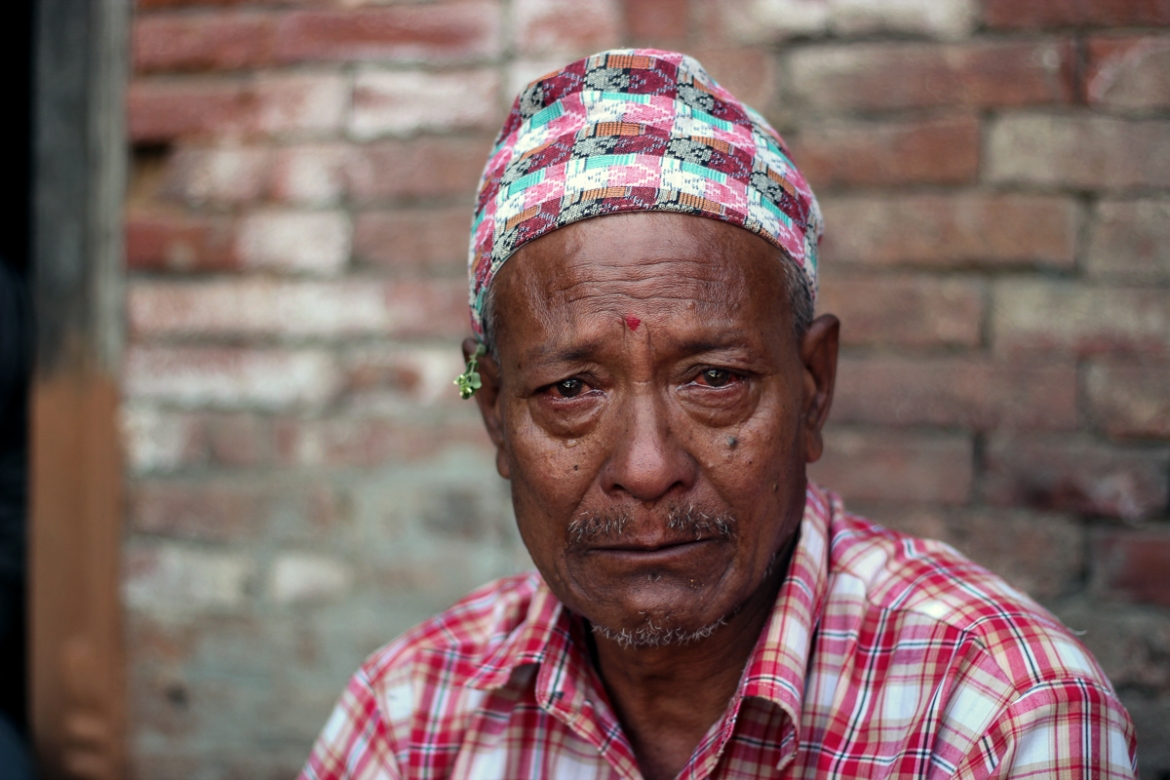Vishnu Prasad Prajapati, 63, potter, Bhaktapur: 'I was making earthenware like any other regular day. I felt someone push me from behind suddenly, but I heard cries outside and I ran out of the house. Within seconds my house had collapsed in front of me. I stood there watching it turn into rubble helplessly. It has been nearly two weeks to the horrific incident and I haven't slept properly since that day. I still get nightmares.' [Showkat Shafi/Al Jazeera]