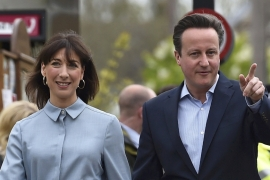 Britain's Prime Minister David Cameron with his wife Samantha on voting day at the UK general election [Reuters]