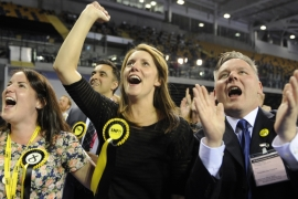 Scottish National Party supporters react to election results at the Glasgow election count in Glasgow [AFP]