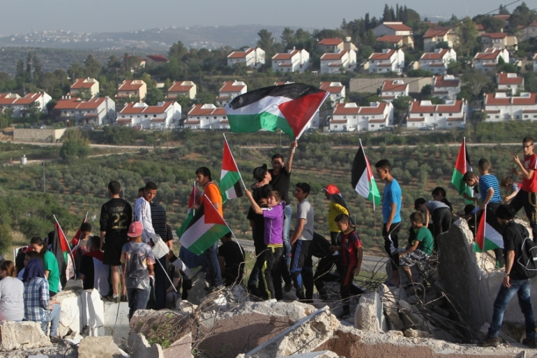 Palestinians from the West Bank protest near the Jewish Hallamish settlement [AFP]