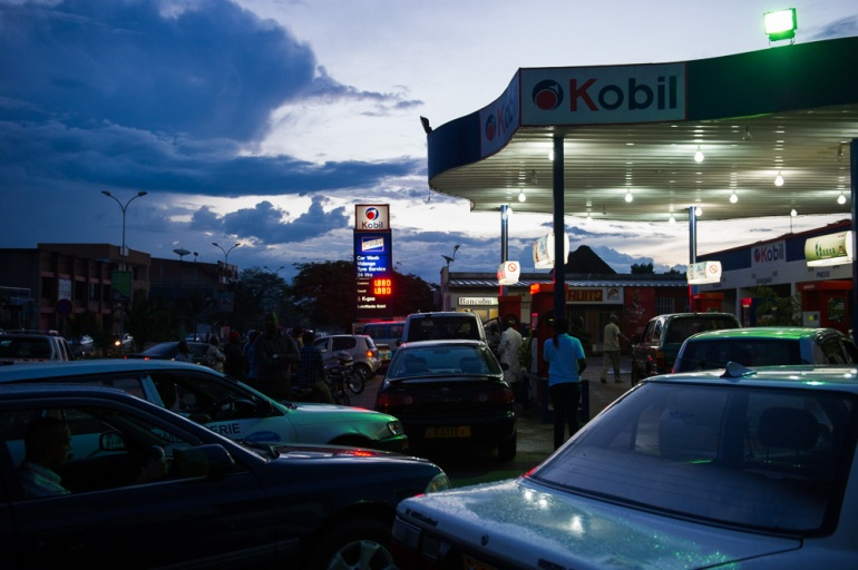 The protests have forced shops to close across the city, and motorists complain of a fuel shortage, queuing for hours to fill their tank. [Phil Moore/Al Jazeera]