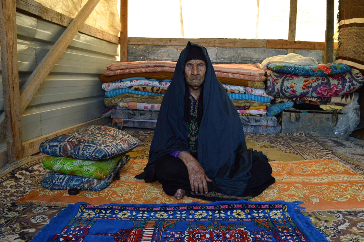Khalil's mother was one of many Bedouins who had to escape to the West Bank after Israeli soldiers expelled them from the Negev desert in 1951. She is 110 years old, completely blind and has her own shack, where she sleeps on a carpeted floor. [Fredrik Brogeland Laache/Al Jazeera]