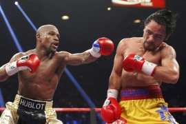 Mayweather defeats Pacquiao in 'most lucrative fight'