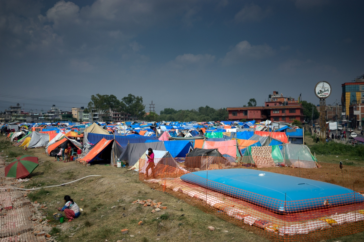 In Chuchepati relief camp, Kathmandu, MSF has installed two water bladders, each with a capacity of 15,000 litres, to provide for the needs of earthquake survivors now residing in temporary shelters, most without any form of flooring. [Brian Sokol/Al Jazeera]