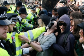 Demonstrators and police clash at the gates of Downing Street during a protest against the Conservative Party on May 9 [Reuters]