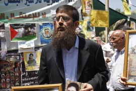 Khader Adnan in 2012, participating in a solidarity rally for prisoners [AP]
