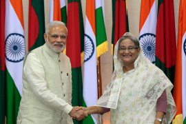 Several Bangladeshi journalists and activists have recently been arrested for making critical remarks against Hasina, right, in the picture here with Modi [File: Anupam Nath/AP Photo]