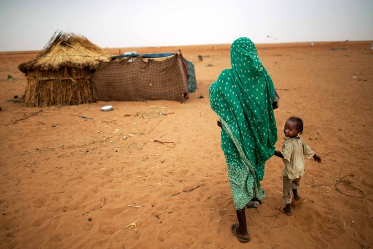 The conflict in Darfur between pro-government forces and ethnic minority rebels left around 300,000 people dead and 2.5 million displaced, according to the UN [Albert Gonzalez Farran/AP]