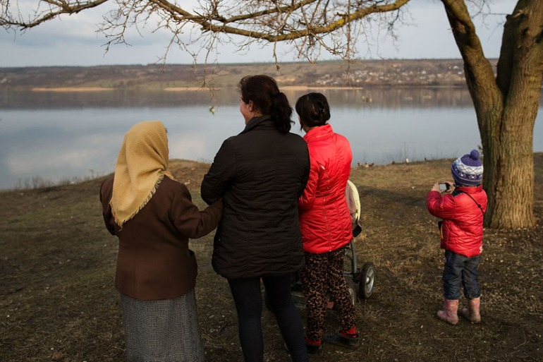 People look over the river Nistru to Transnistria on the border with Ukraine, which declared its independence from Moldova in 1990 [Carsten Koall/Getty Images]