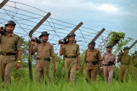 Indian Border Security Force soldiers patrol the India-Bangladesh border [AP]