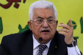 Analysts charge Abbas' latest move is aimed at ridding the PA of critics, entrenching cronies, and shoring up a facade of reform [AP]