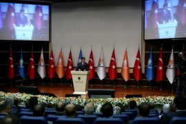Davutoglu gives a speech during a meeting of the AK party in Ankara, Turkey on June 16 [AFP]