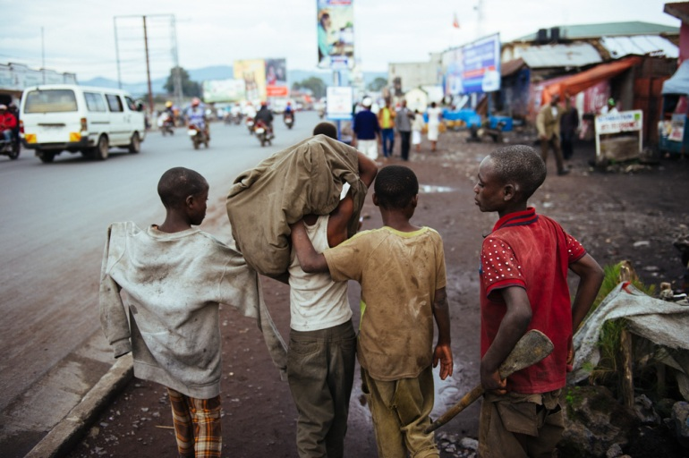 Goma has many street children, often orphans or those abandoned by their parents. They roam the city together for safety, but also often engage in petty crime. [Phil Moore/Al Jazeera]