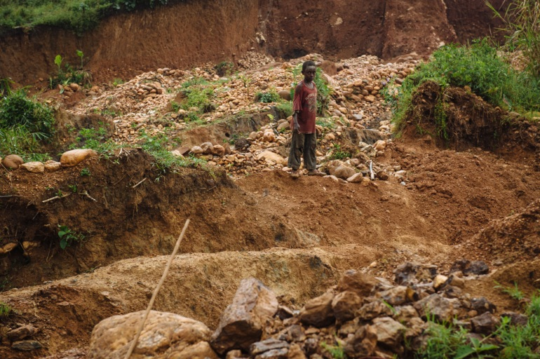 A young boy in an illegal gold mining site in South Kivu, where he helps his father. [Phil Moore/Al Jazeera]