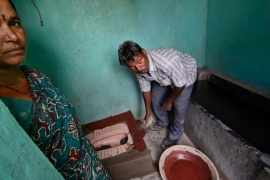 Rukmini Banavathi and her husband Venkatesh built their new latrine by hand, and anticipate the government financial reimbursement in India's Pendlimanu village [Zigor Aldama/Al Jazeera]