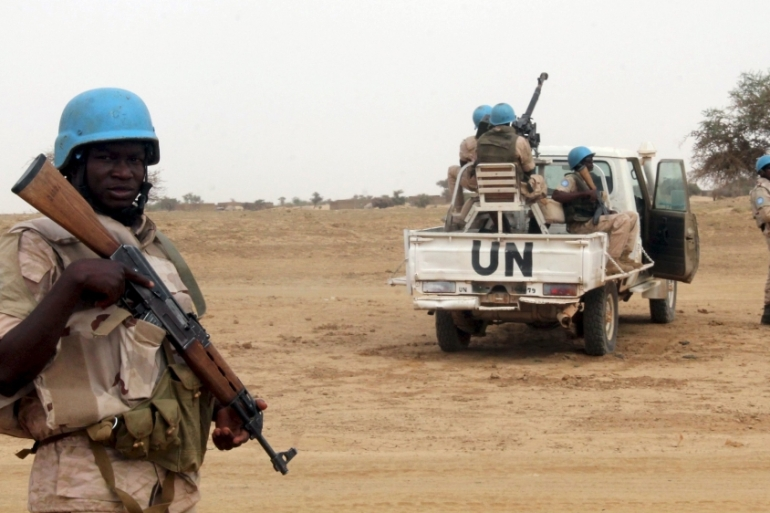 UN peacekeepers stand guard in the northern town of Kouroume, Mali [File: Adama Diarra/Reuters]