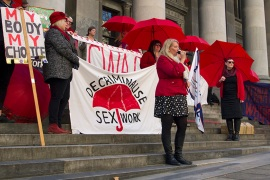 The South Australian Sex Workers Industry Network and the Scarlet Alliance held a rally to mark the 40th anniversary of International Sex Workers Day [Royce Kurmelovs/Al Jazeera]