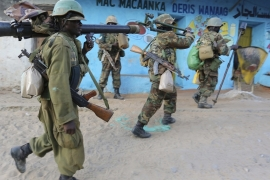 Somali army soldiers and peacekeepers from the African Union Mission in Somalia [File: Feisal Omar/Reuters]