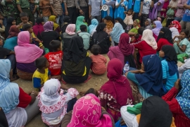 Myanmar Rohingya people at new temporary shelters in Blang Adoe, Indonesia [AFP]