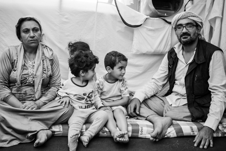 Nuri Khan lives at the Kawergosk camp with his pregnant wife and their three young children [Megan O'Toole/Al Jazeera]