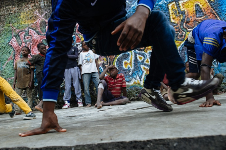 Faraja and a group of young dancers called Rhina Crew bring together the street children with other kids, 'so that they all understand they're the same', Faraja said. 'The street children have the same rights and they can do the same things.' [Phil Moore/Al Jazeera]
