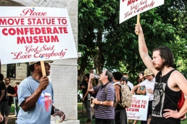 Activists joined demonstrations in the summer heat at the front of a confederate monument in Texas [Shaghayegh Tajvidi/Al Jazeera]