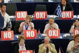 "Members of the European Parliament with posters with the word ""No"" (Oxi in Greek) attend a debate on Greece at the European Parliament in Strasbourg [Vincent Kessler/Al Jazeera]"