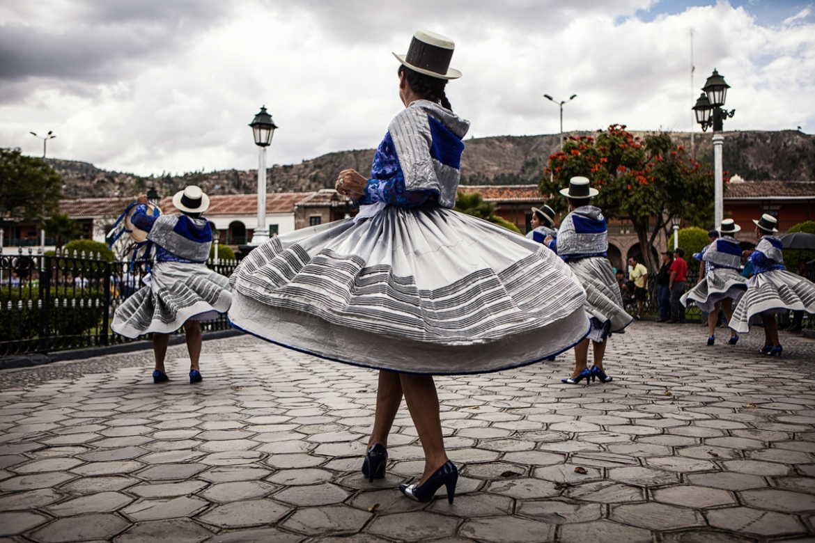 Traditional dancers performed in the main square in Ayacucho during a ceremony remembering the victims of the conflict. [Nadia Shira Cohen/ICRC]