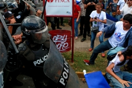 Police beat and detained government opponents at a protest outside Nicaragua's electoral council [EPA]