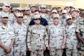 Egyptian President Abdel Fattah el-Sisi, centre, poses for a photograph with members of the Egyptian armed forces. [Reuters]