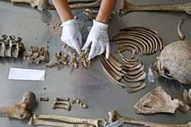 Senior forensic anthropologist Dragana Vucetic of the International Commission on Missing Persons (ICMP) works to identify the remains of a victim of the Srebrenica massacre [Dado Ruvic/Reuters]