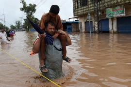 Monsoon rains hit Pakistan leading to swollen rivers and water channels damaging hundreds of villages [AFP]