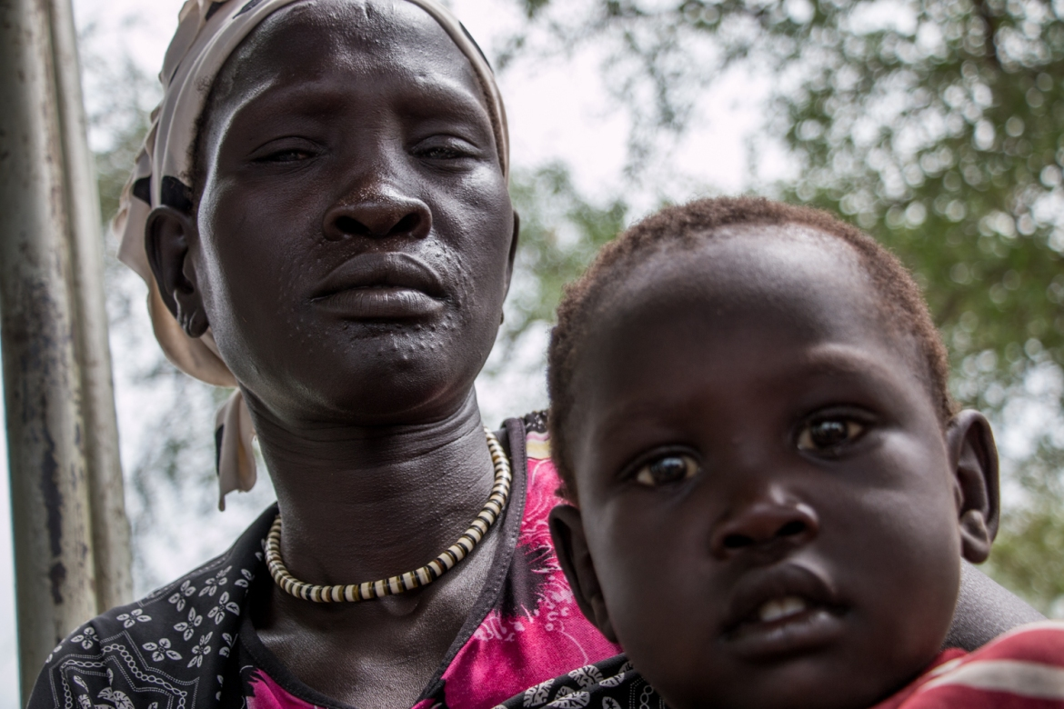 Nyaway Gatluok is seven months pregnant and arrived in Fangak two weeks ago. She lost her husband and one daughter during the chaos of government attacks on her village [Ashley Hamer/Al Jazeera]