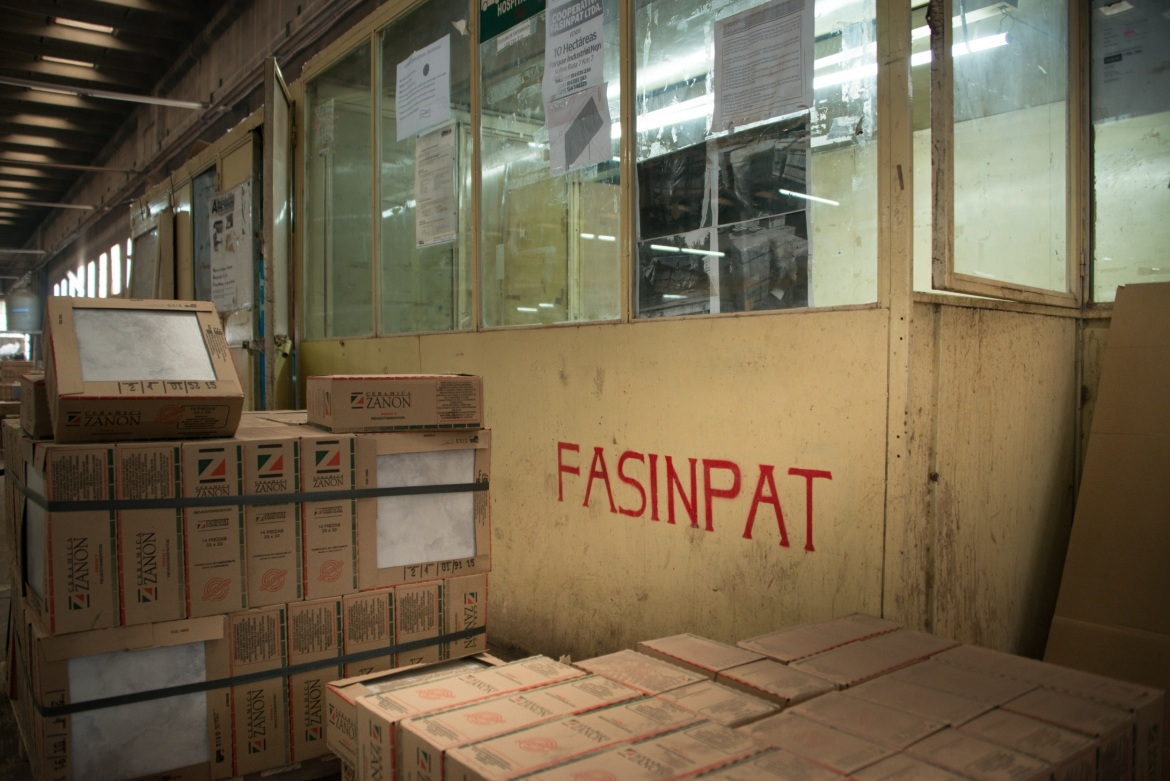 The factory was renamed from Zenon to Fasinpat, an acronym for 'Factoria Sin Patrones' - 'Factory Without Bosses'. [Yiannis Biliris/Al Jazeera]