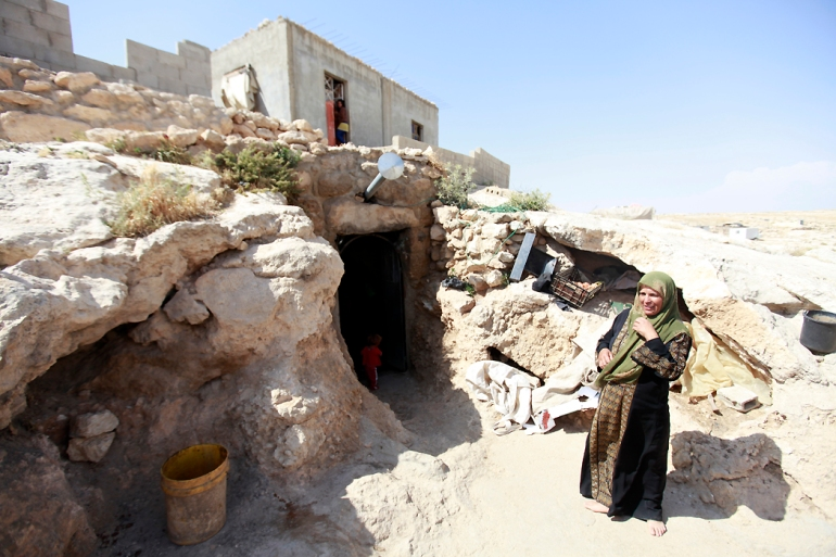 In May 2012, the Hamamdi family built a brick house on top of the cave to accommodate their numerous children. But less than a month later, the Israeli Civil Administration issued a demolition order for the new home. [Eloise Bollack/Al Jazeera]