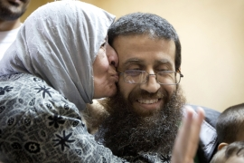 Khader Adnan has been imprisoned 10 times by Israel for a total of about six years - without charge [AP]
