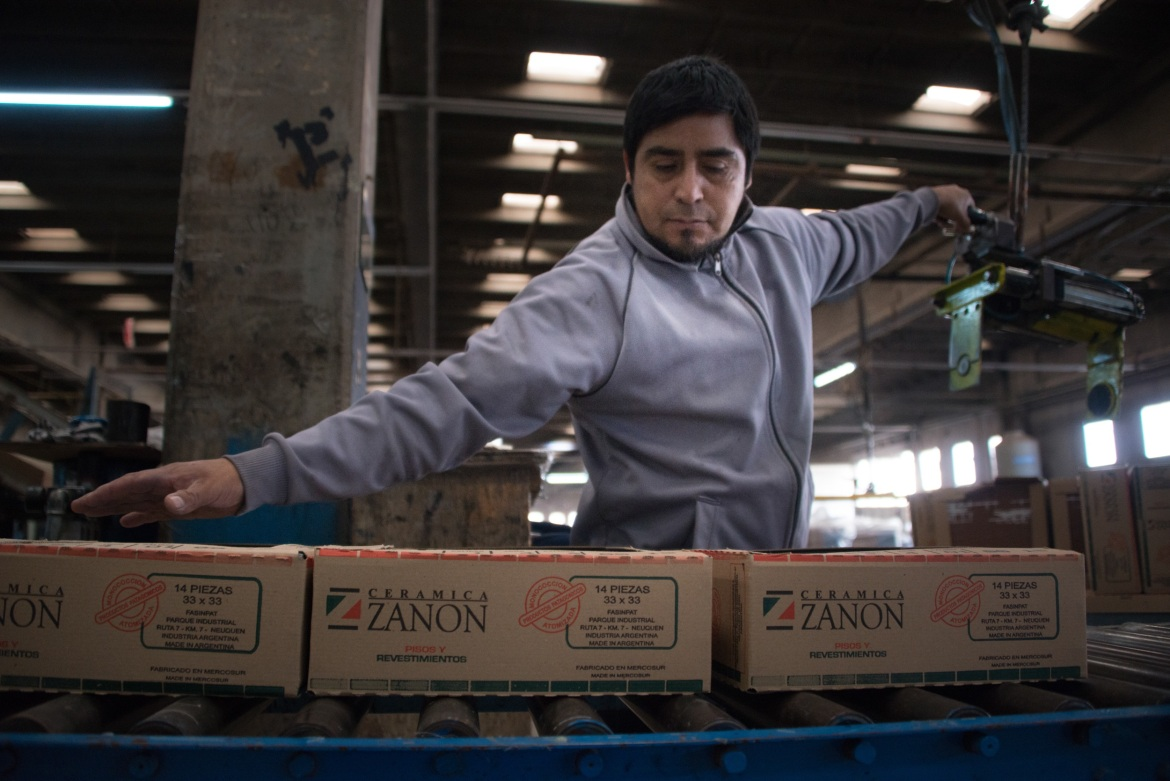 The packaging of the tiles still carries the original Zanon logo, next to the new name, Fasinpat, as an administrative reference. [Yiannis Biliris/Al Jazeera]