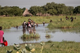 Thousands of people displaced by fighting in Unity State have crossed swampy waterways to reach the relative safety of the distant rebel controlled territories [Ashley Hamer/Al Jazeera]