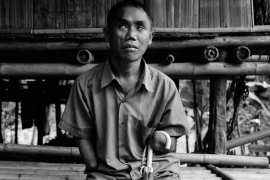 Panyuk's arms were blown off and he was blinded by a landmine explosion in Myanmar. He now spends his time singing songs and telling stories about traditional Karen culture [Jack Picone]