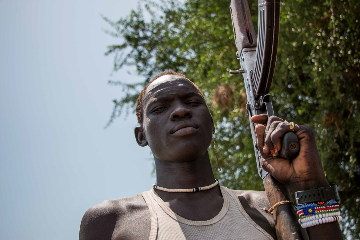 The frontline is a long way from Waat, but young men from the Nuer community here continue to travel to the front to fight. It is not unusual for them to also carry weapons to protect their isolated properties and herds of livestock.  [Ashley Hamer/Al Jazeera]