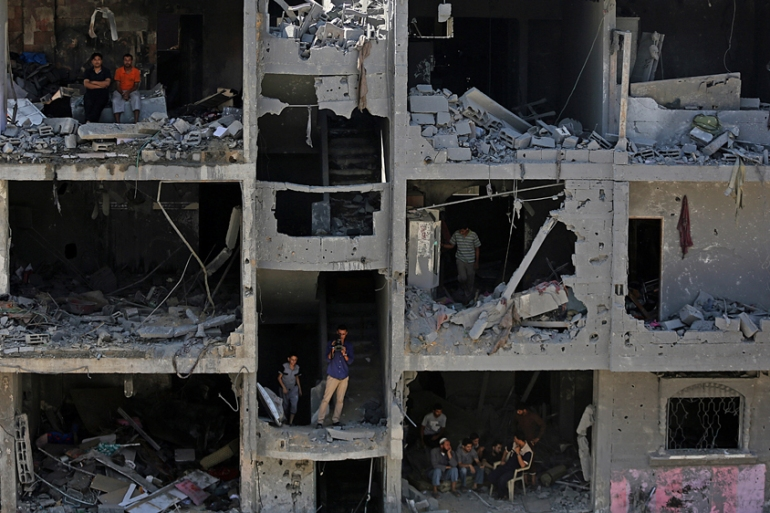 Last year's war on Gaza displaced half-a-million people and left parts of the strip destroyed [EPA]