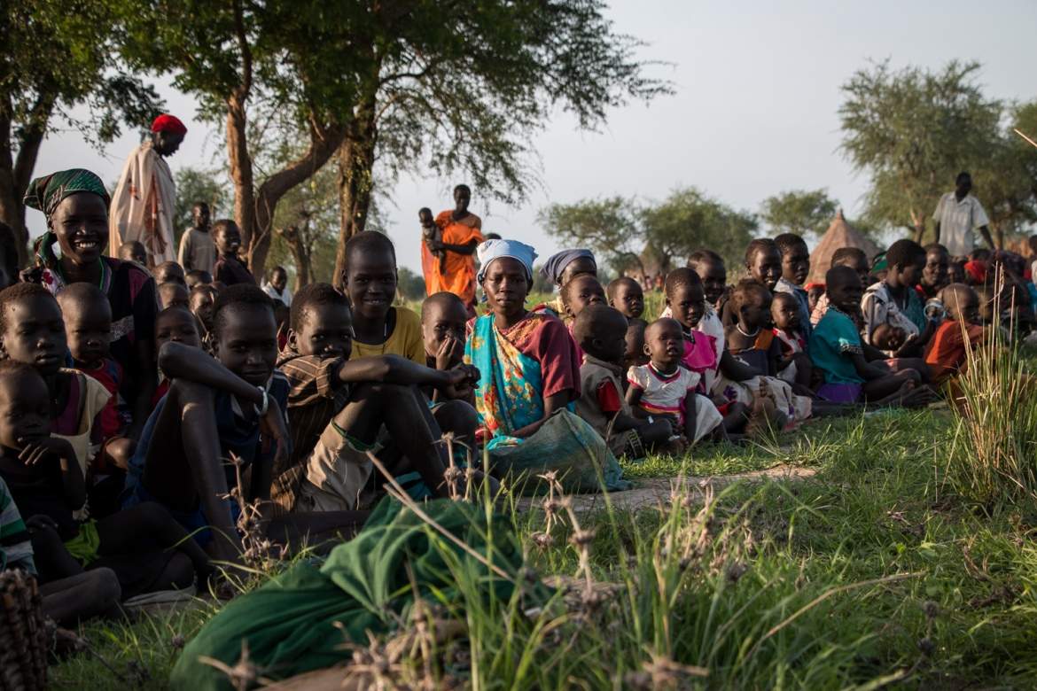 Many families - mainly women and children - arrived in the early hours of the morning and waited for hours to be registered and receive assistance [Ashley Hamer/Al Jazeera]