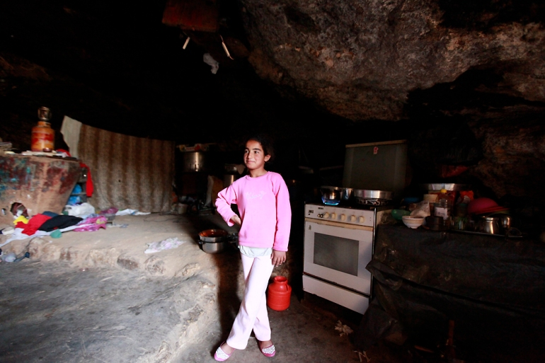 The family of Saheer Hamamdi is one of the few who could afford to bring a stove into their dwelling. Most families use simple cooking cylinders. [Eloise Bollack/Al Jazeera]