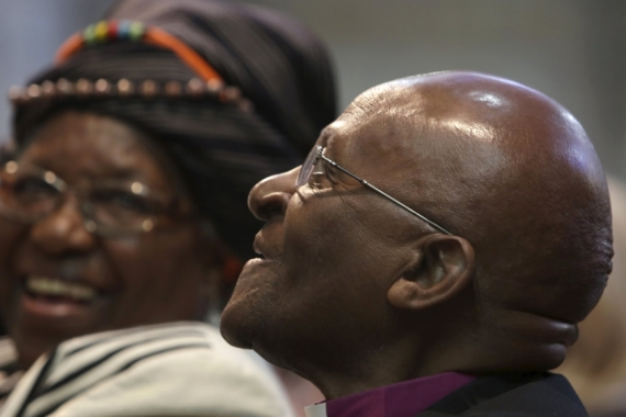 Tutu and his wife Leah share a moment shortly before renewing their vows as they celebrate their 60th wedding anniversary [Reuters]