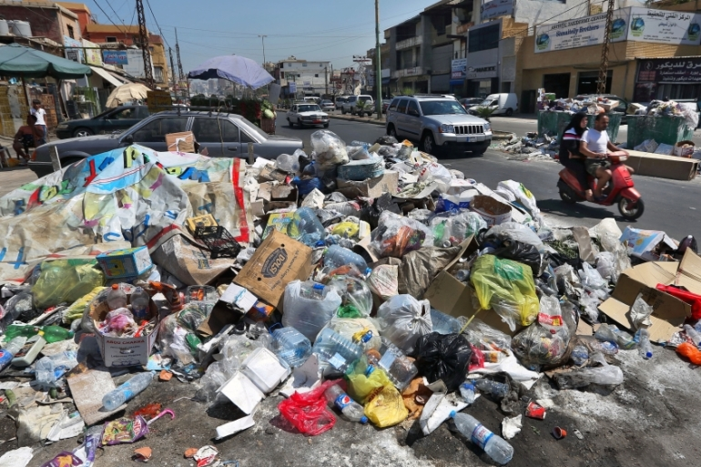 The stench of uncollected refuse in the streets of Beirut is a stark reminder of the crisis of government afflicting Lebanon [AP]
