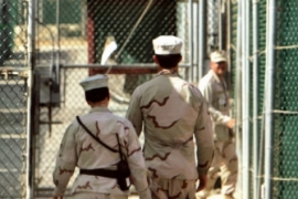Despite pledges, Guantanamo Bay remains open